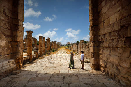 Active Couple with Pleasure Visiting Ruins of Tire. Enjoying Majestic Ancient Architecture. Spending Romantic Vacation in Lebanon.
