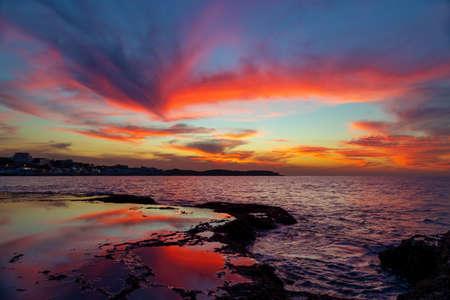 Beautiful Landscape of an Amazing Sunset Sky over Beach. Coastal Fishing Village. Traveling to Northern Lebanon. Anfeh.