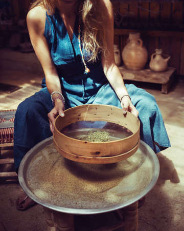 Woman Making Homemade Spices, Dry Zaatar. Traditional Lebanese Seasoning. Natural Antioxidant. Banque d'images