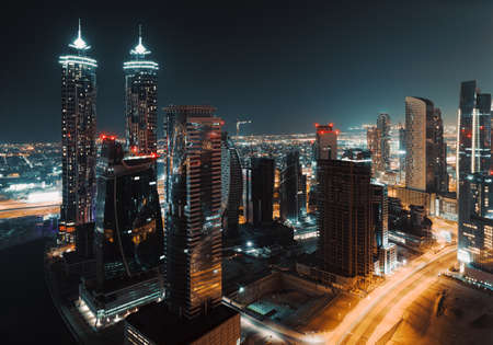 Beautiful Cityscape of a Modern Futuristic Buildings and Towers in the Lights of a Night City. Beauty of Luxury Life of Emirates. Dubai. United Arab Emirates. Standard-Bild