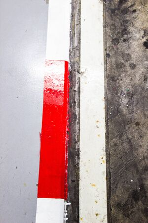 White and red no parking sign on footpath