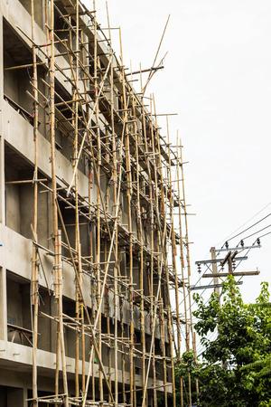 concrete commercial block: Construction site with scaffolding