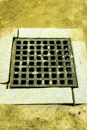 to grate: Drain grate in concrete floor as abstract background