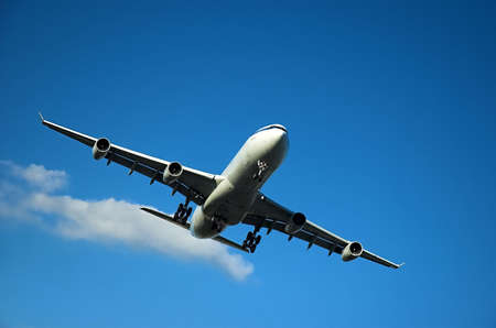 Airplane approaching to land during sunny day
