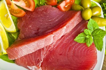 raw tuna steak with spice photo