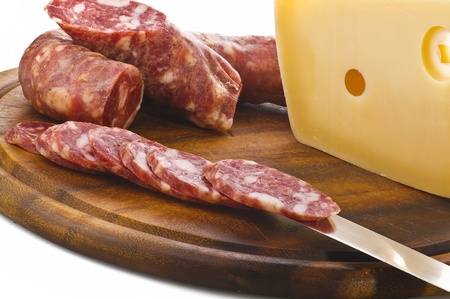 Hot salami with cheese on wood photo