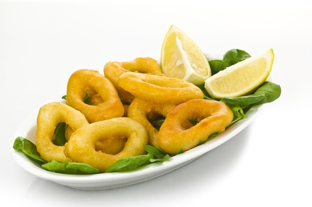 pescado frito: squid rings on plate with salad