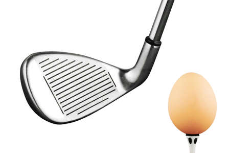 Photo of a golf iron club and egg photo