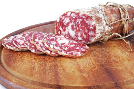 embutido: Salami sliced on the white