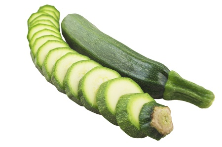 consumables: Raw Zucchini close up on white