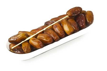 date fruit: Dates close up on the white
