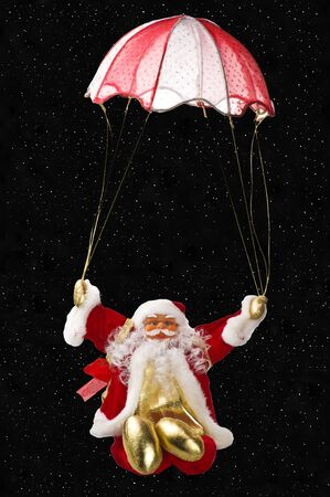 Santa Claus fly with parachute Stock Photo - 10622506