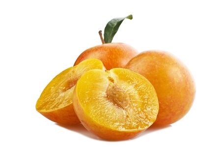 Yellow plums on the white