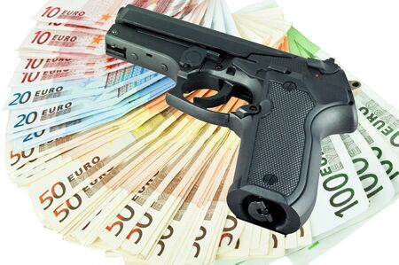 gun and money on white photo