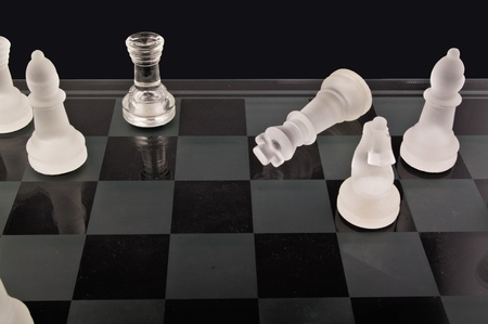 Chess on the black background photo