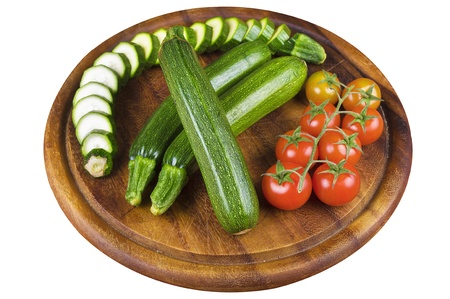 grower: Raw Zucchini and tomatoes on wood
