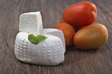 fresh cheese close up on wood table photo