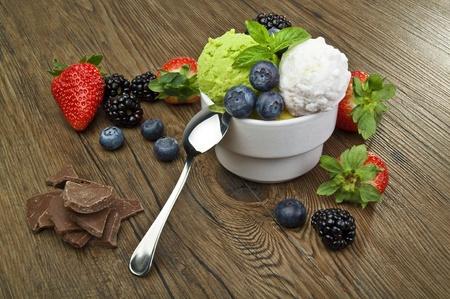 fruit ice cream close up on wood table photo