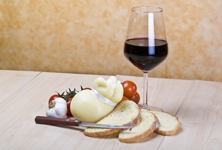 scamorza cheese: Scamorza cheese and sliced bread on wood Stock Photo