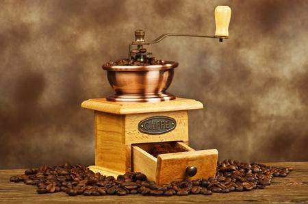 caf: Vintage coffee grinder with coffee beans