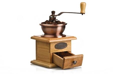 Vintage hand coffee grinder on white photo