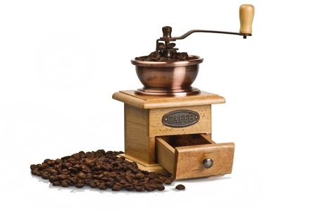 Vintage hand coffee grinder on white photo