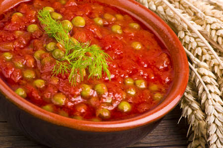 Sauce of tomatoes and fresh green peas  photo