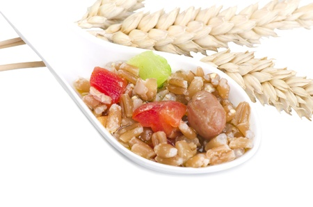 Spelt soup on the white spoon photo