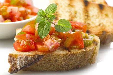 fresh bruschetta with tomato ,olive oil ,garlic and oregano photo