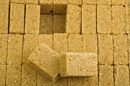 brown lump cane sugar cubes close up photo