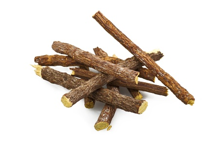 wood stick: licorice root close up on the white