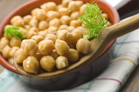 Spoon of chickpeas with fennel leaves,closeup shoot