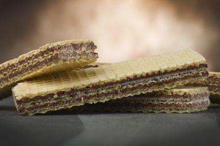 chocolate wafer in different position on the table photo
