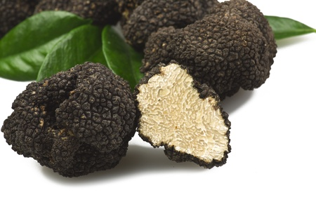 truffles: freshly harvested truffles  and sliced close up  Stock Photo