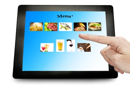 man hand touching on a tablet pc photo