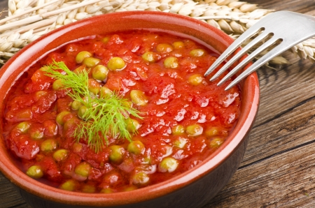 Sauce of tomatoes and fresh green peas c photo