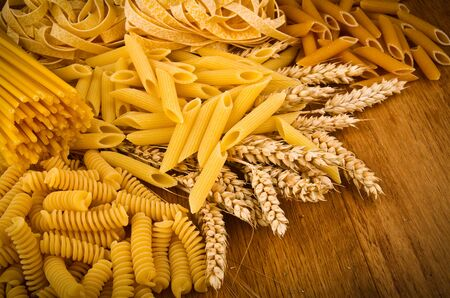 ailment: Mix group of italian pasta on the wood table Stock Photo