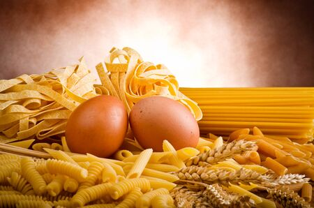 genuine good: Mix group of italian pasta on the wood table Stock Photo