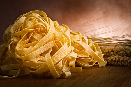group of italian homemade pasta tagliatelle on wood Stock Photo