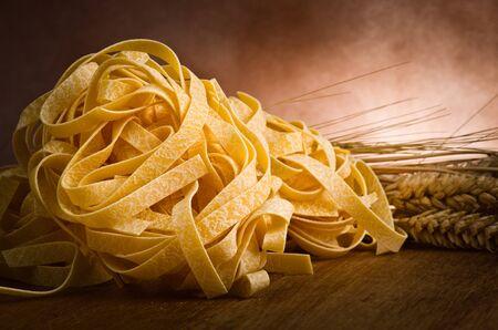 nutriments: group of italian homemade pasta tagliatelle on wood Stock Photo