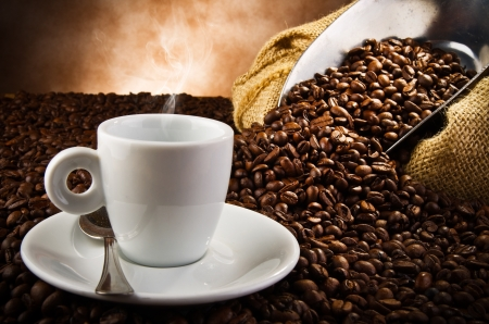 Coffee smoking on the coffee beans background photo