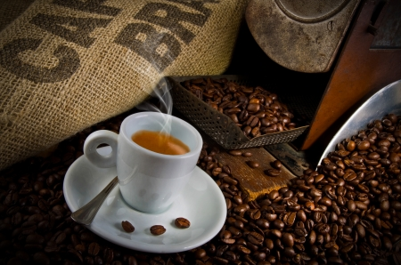 coffe beans: Coffee smoking on the coffee beans background