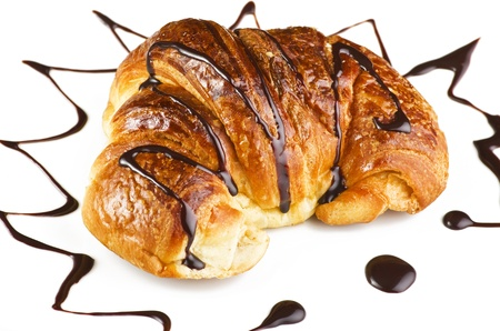 Fresh and tasty croissant on the white Imagens