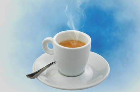 Coffee smoking on the blue sky background photo