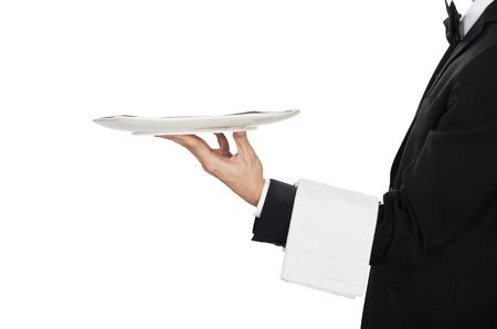 busboy: young waiter in work uniformon the white
