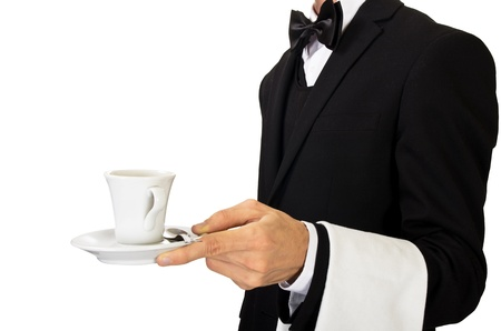 busboy: young waiter in uniform serving hot coffee Stock Photo