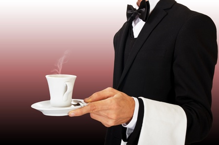 young waiter in uniform serving hot coffee Stock Photo