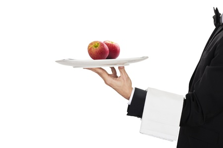 busboy: waiter in work uniformon with two red apples Stock Photo