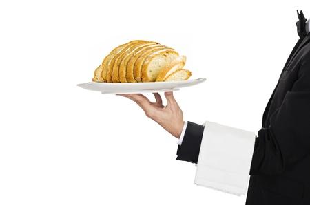 busboy: waiter in work uniformon with sliced bread