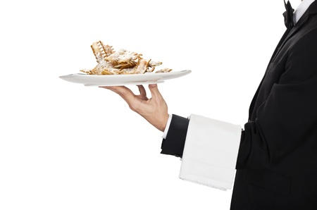 busboy:  waiter in work uniformon with italian carnival cake chiacchere Stock Photo